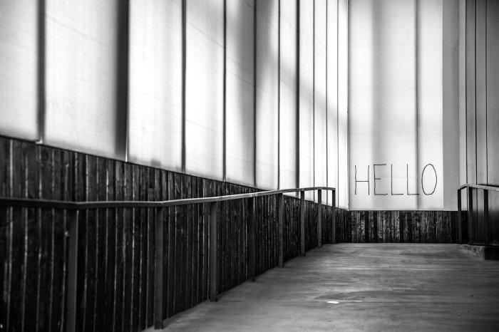 Hello graffiti at end of walkway.