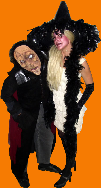 da-AL and her husband in Halloween costumes: monster and witch