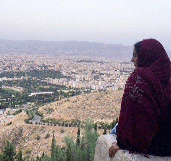 Roseoverlooking the beautiful city of Shiraz after a morning hike with herfamily.