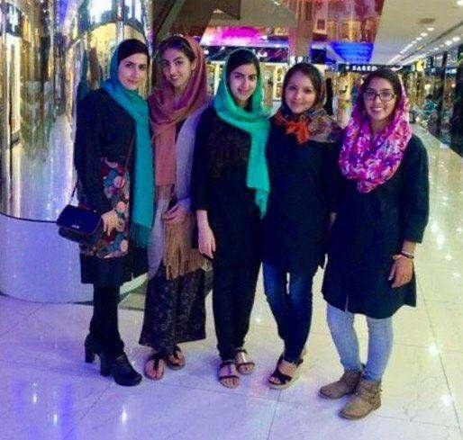 "Rose and friends at a shopping mall in Shiraz, Iran. She addes, ""Note the personal fashion, makeup, and hair being out."""