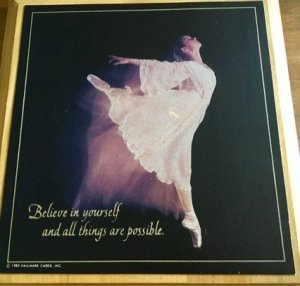 """Photo of framed ballerina poster with quote, """"Believe in yourself and all things are possible."""""""