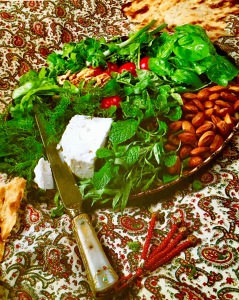 Platter of fresh herbs, feta, and nuts.