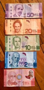 Paper currency is super colorful and bills come in different sizes.
