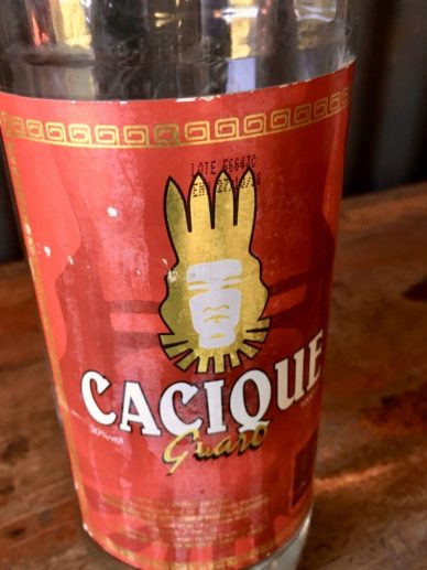A bottle of Cacique: potent fermented sugar cane alcohol.