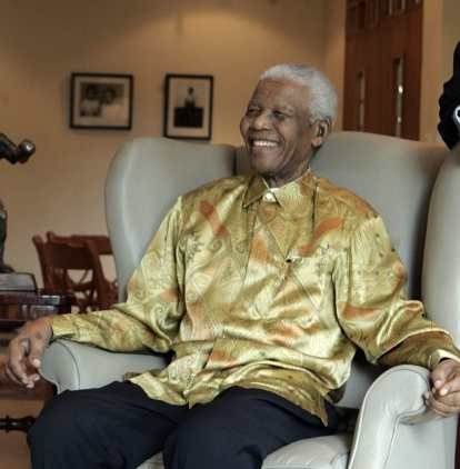 Nelson Mandela wearing the colorful 'Madiba' shirts he became known for. Photo courtesy of Wiki
