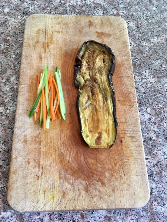 Julienned cucumbers and carrots with roasted eggplant slice.