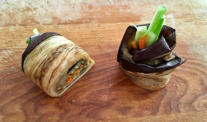 Eggplant rollups cut in half.