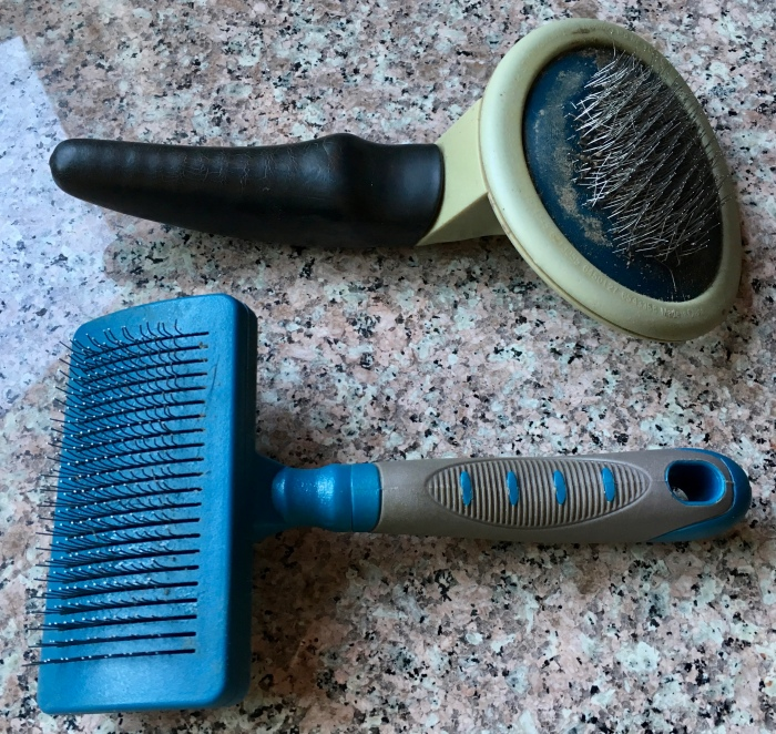 Slicker brushes for cats and dogs.