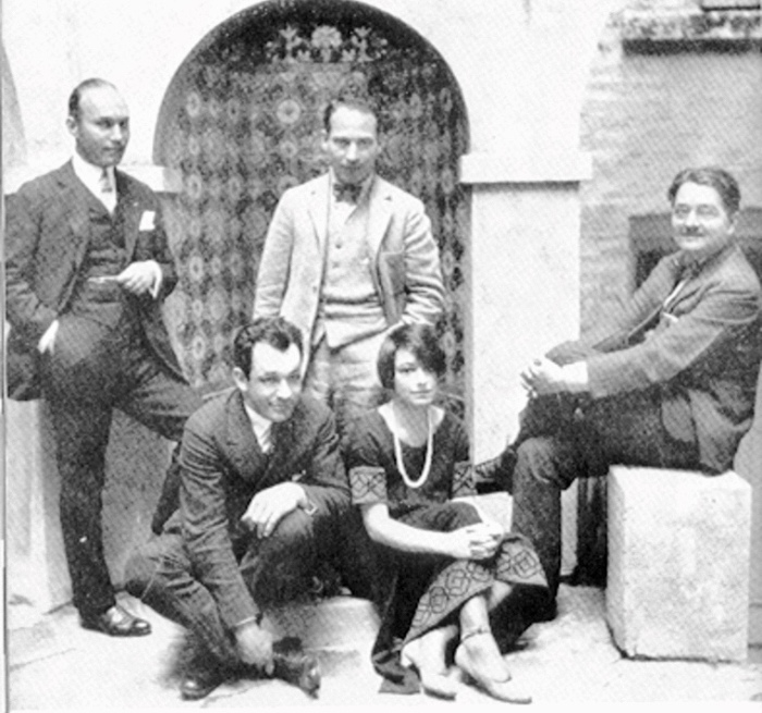 Members and associates of the Algonquin Round Table: (standing, left to right) Art Samuels and Harpo Marx; (sitting) Charles MacArthur, Dorothy Parker, and Alexander Woollcott