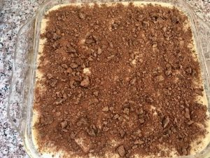 The second layer for the tiramisu completed with what's left of the chunked chocolate, and dusted with cacao powder, then chilled for at least 4 hours.