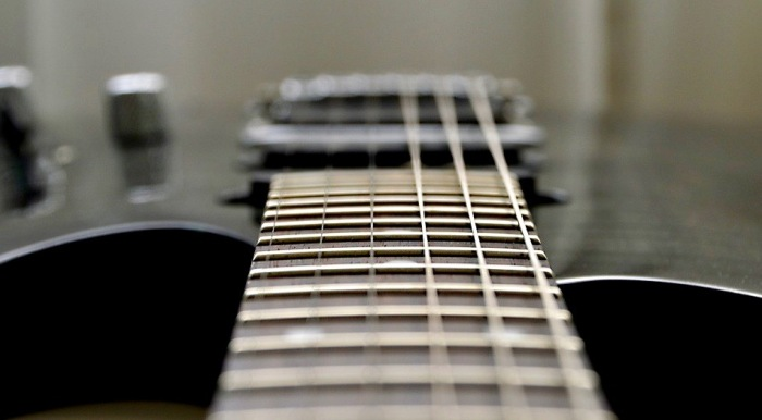 Photo looking down neck of a guitar