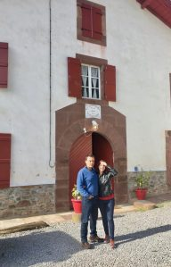 Author and husband in front of French farmhouse
