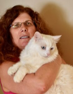 Cat owner and her white, blue eyed kitty.