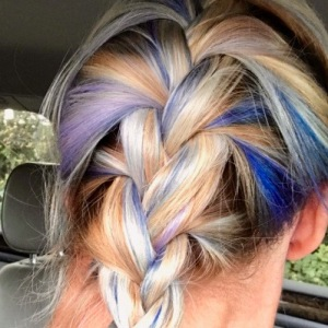 Photo of the back of Viola Blue's head, her mullticolored braid