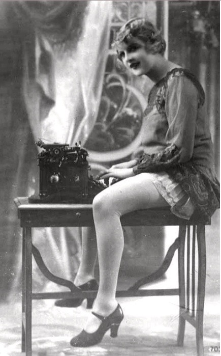 1930s or so black & white photo of young woman typing