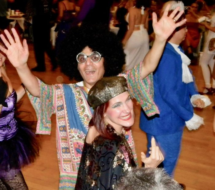 da-AL and her husband in Halloween 1970s disco costumes.