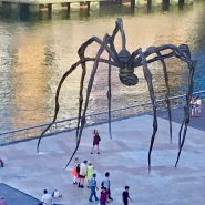 I'm waving hi to you from the feet of Maman (Ama) by Louise Bourgeois.