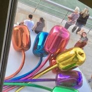 "A shot of me from an upstairs window, admiring Jeff Koons' ""Tulips."""
