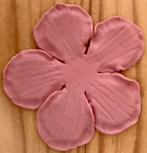 A rose-shaped layer of fondant.