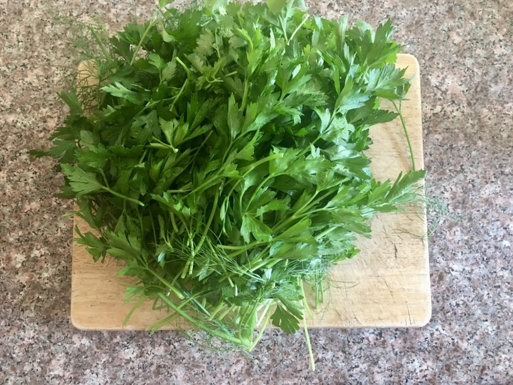 Chopping fresh herbs like this Italian parsely make the whole house smell wonderful!