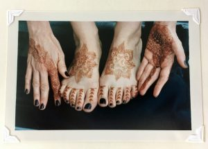 Photo of my henna tattooed hands and feet.
