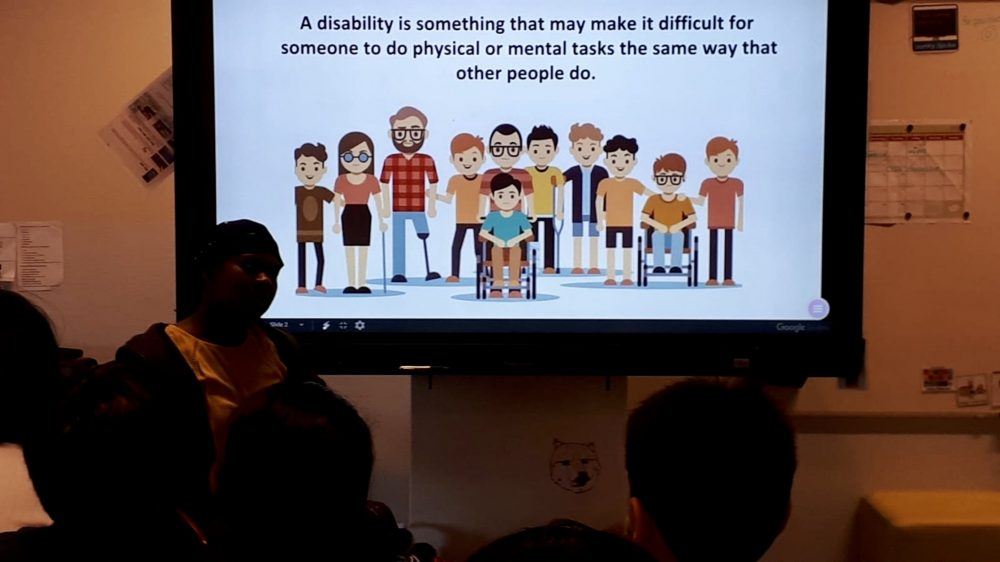 Photo of The Wheelchair Teen giving a presentation about disabilities to children at a primary school.