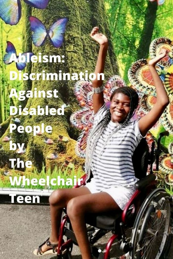 The Disabled Teen having fun in front of a carnival wall.
